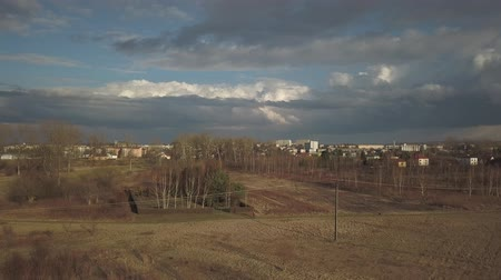 Autumn panorama of a European city with a birds-eye view. Shooting from the drone or quadrocopter. Planning of architectural and landscape design. Stormy sky with rain clouds