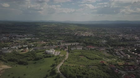 Panorama from a birds eye view. Central Europe: town or village is located among the green hills. Temperate climate. Flight drones or quadrocopter