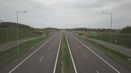 Panorama of the motorway with a birds eye view. Transport artery of the country. The movement of vehicles on the highway. Landscape design of communication paths. Roadworks and marking. Stream cars Stock Footage