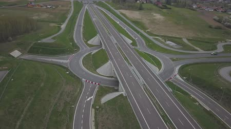 işaretler : Panorama of the motorway with a birds eye view. Transport artery of the country. The movement of vehicles on the highway. Landscape design of communication paths. Roadworks and marking. Stream cars Stok Video