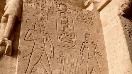 faraon : Scenes from the life of Ramses II in low-relief at the entrance of the Abu-Simbel Temple Egypt