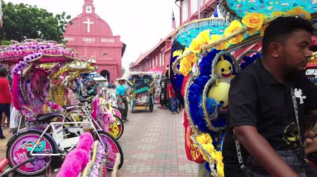 rickshaw : MALACCA, MALAYSIA - 15 SEPTEMBER 2019: Tourist at Dutch Square in Malacca, Malaysia.It has been listed as UNESCO World Heritage Site since 2005