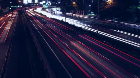 Seamless loop of night highway traffic time lapse during rush hour Wideo