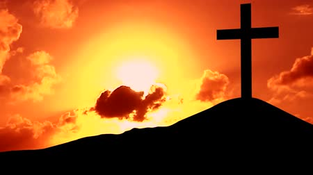 çapraz : Video footage of silhouette of christian cross on the hill with red sunset sky
