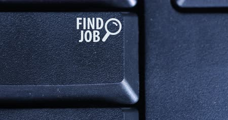 вакансия : Close up of human finger pressing a button of Find Job on the computer keyboard