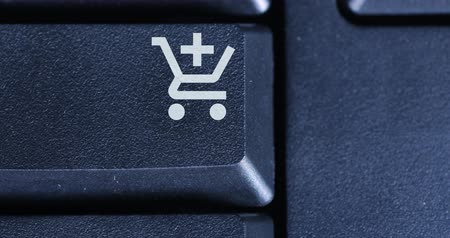 add to cart : Closeup of human finger pushing a shopping cart button on the computer keyboard
