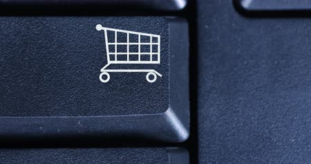 add to cart : Macro video footage of human finger pressing a shopping cart key on the computer keyboard