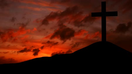 çapraz : Video footage of silhouette of a christian cross on the hill at sunset time