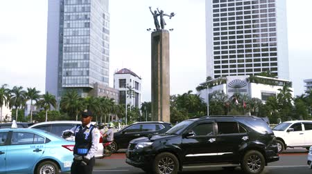 indonesia : Timelapse of busy road with an Welcome Monument in Central Jakarta, Indonesia