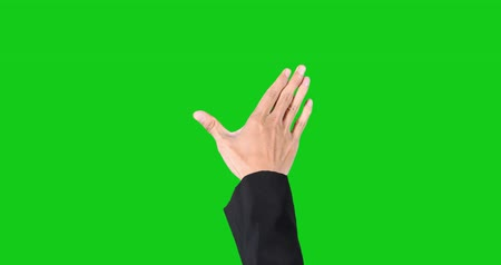 csip : Businessperson hand zoom in and zoom out virtual button on the touch screen with green screen background Stock mozgókép