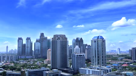 indonesia : Timelapse of modern office buildings with clear sky in Central Jakarta, Indonesia