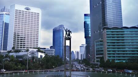 indonesia : Timelapse of Welcome Monument with skyscraper in the Central Jakarta, Indonesia