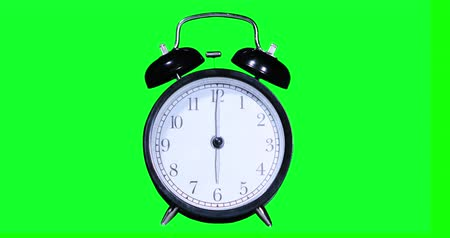 pm : Video footage of an alarm clock ringing at six oclock, shot with green screen background. Professional shot in 4K resolution Stock Footage