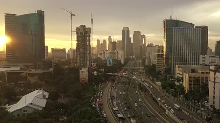 indonesia : JAKARTA, April 12, 2017: Aerial view of skyscraper and traffic jam on the Jakarta highway, Indonesia. Shot at sunset time