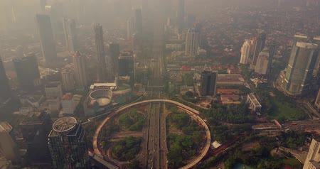 indonesia : Video footage of aerial view of highway intersection with skyscrapers in Jakarta, Indonesia. Shot in 4k resolution