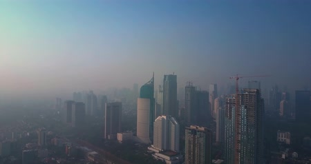 indonesia : Video footage of beautiful aerial view of skyscrapers with smoke on the morning in Jakarta City, shot in 4k resolution