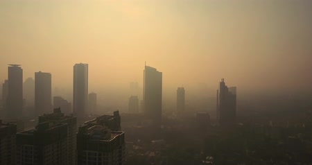 táj : Video footage of bird view of cityscape view of Jakarta with skyscraper on misty morning in Indonesia. Shot in 4k resolution