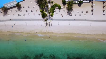 holiday villa : Aerial view footage of white sand beach with swimming pool in a resort at Nusa Dua, Bali, Indonesia. Shot in 4k resolution