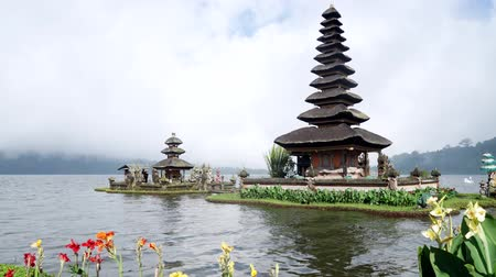 bratan : Time lapse of beautiful scenery in Ulun Danu Bratan Temple with moving cloud at Tabanan, Bali, Indonesia