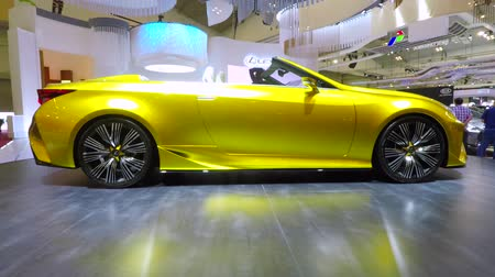 car logo : JAKARTA, Indonesia. August 23, 2017: Video footage of a sporty Lexus car with yellow color shown at Gaikindo Indonesia International Auto Show (GIIAS) in Jakarta Stock Footage