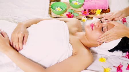 salt bed : Video footage of a young woman enjoying facial treatment by face massage in the beauty salon