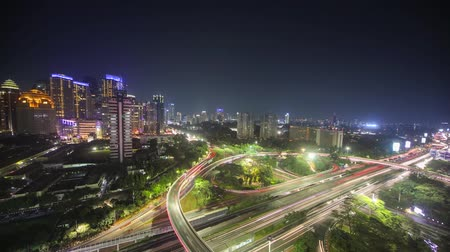 stopmotion : Beautiful aerial stop motion footage on Semanggi flyover with blurred vehicle lights and skyscraper view at night in Jakarta, Indonesia