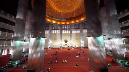 red symbol : JAKARTA, Indonesia. September 14, 2017: Beautiful view footage inside Istiqlal Mosque with high column, red carpet, and dome