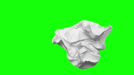 duvar kağıdı : Timelapse of crumpled paper ball on green screen background, shot in the studio