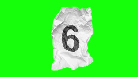 amarrotar : Footage of countdown numbers on crumpled paper texture with green screen background