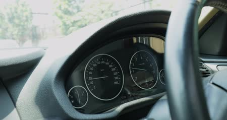 mph : Closeup of car dashboard with speedometer and steering wheel, shot in 4k resolution on highway