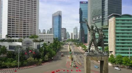 sudirman : JAKARTA - Indonesia. December 28, 2017: Aerial view of Selamat Datang Monument or Welcome Monument and Sudirman street in Hotel Indonesia roundabout. Shot in 4k resolution Stock Footage