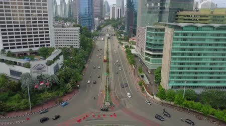 sudirman : JAKARTA - Indonesia. December 28, 2017: Aerial footage of Selamat Datang Monument or Welcome Monument in Hotel Indonesia roundabout. Shot in 4k resolution