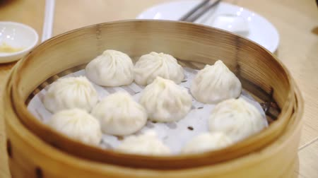 dimsum : Closeup of chinese steamed dim sum served with a bamboo container on the table in the restaurant
