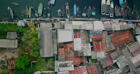 slum house : Top view of slum fishing village and fisherman boats near Sunda Kelapa port in Jakarta city, Indonesia. Shot in 4k resolution
