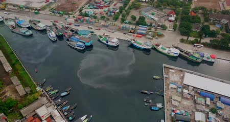 slum house : Aerial view of slum fishermen homes and ships at the old Sunda Kelapa port in North Jakarta, Indonesia. Shot in 4k resolution Stock Footage