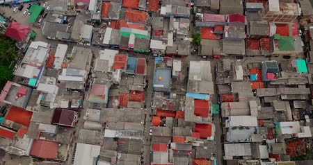 quadrilha : Aerial landscape from a drone flying above crowded slum fishermen homes near Sunda Kelapa port at North Jakarta, Indonesia. Shot in 4k resolution