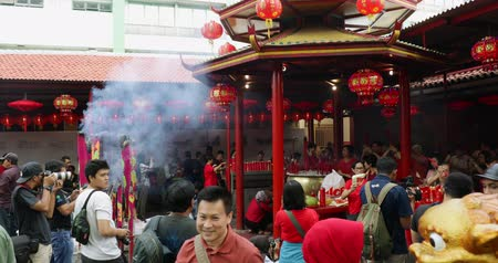 myrrh : JAKARTA - Indonesia. March 26, 2018: Crowded photographers taking picture of buddhist people on Chinese New Year celebration in Vihara Dharma Bhakti. Shot in 4k resolution Stock Footage