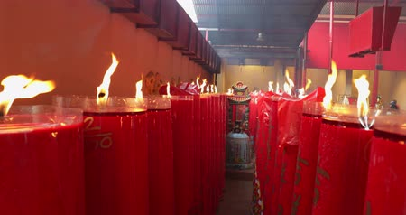 myrrh : JAKARTA - Indonesia. March 26, 2018: Many burning red candles in the Jin De Yuan Templeat Petak Sembilan located in the Chinatown Glodok. Shot in 4k resolution