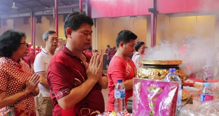 myrrh : JAKARTA - Indonesia. March 26, 2018: Man praying with an incense pot to celebrate Chinese New Year at Vihara Dharma Bhakti in Petak Sembilan, Glodok, Jakarta. Shot in 4k resolution