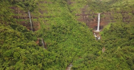 назад : Beautiful aerial view of Cikanteh, Ciateul, and Sodong waterfall from a drone flying backward at Ciletuh Geopark, Sukabumi, West Java, Indonesia. Shot in 4k resolution