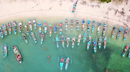 ancorado : Beautiful aerial landscape of anchored fisherman boats in a row at Ujung Genteng beach, Sukabumi, West Java, Indonesia