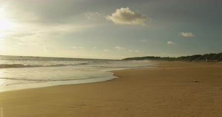 západ : Exotic landscape of Pangumbahan beach with white sand and clear sky on dusk time at Ujung Genteng, Sukabumi, West Java, Indonesia. Shot in 4k resolution Dostupné videozáznamy