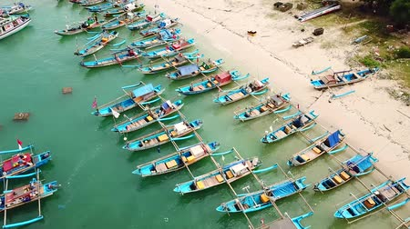 ancorado : Sukabumi, West Java - Indonesia. April 12, 2018: Beautiful aerial view of anchored fisherman boats on the Ujung Genteng beach at Sukabumi, West Java, Indonesia