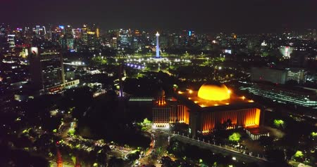 minaret : Beautiful aerial scenery of Istiqlal mosque with National Monument background at night in Jakarta, Indonesia. Shot in 4k resolution