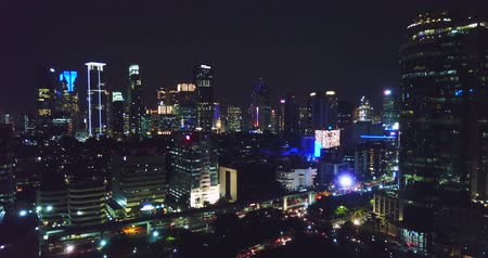 panorâmico : Beautiful aerial panorama of Jakarta downtown with skyscrapers and stunning night lights. Shot in 4k resolution