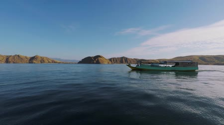 архипелаг : Traditional wooden boat sailing on the sea with beautiful landscape near the Komodo Island at East Nusa Tenggara, Indonesia Стоковые видеозаписи