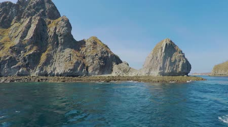 sail rock : Beautiful landscape of cliff and clear sea on an island near Komodo Island from a boat at East Nusa Tenggara, Indonesia