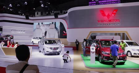 hall : JAKARTA, Indonesia - April 27, 2018: Wuling Motors stand showing Confero S and Cortez car at Indonesia International Motor Show - IIMS 2018. Shot in 4k resolution