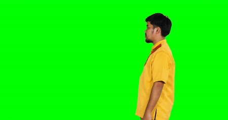 головной убор : Eid Mubarak concept. Muslim couple giving a greeting hand gesture tradition to each other during Eid Mubarak in front of green screen background. Shot in 4k resolution