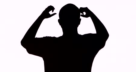 unknown : Silhouette of unknown man celebrating his success by raising arms in the studio, isolated on white background. Shot in 4k resolution